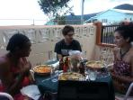 engaging in light banter with the guests....dinner was salmon mousse with pasta, local fruit drink