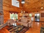 Open concept F/R / walkout to deck,F/P,  views from every door & window,48' covered deck. Beautiful!