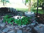 Patio area with Barbaque and pond