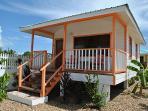 Orange Starfish Cabana at Latitude Adjustment in Hopkins Belize