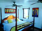 Bed in Yellow Tale Snapper Cabana At Latitude Adjustment in Hopkins Belize