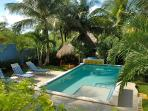 Lounging Area In The Pool To Stay Cool - Lovely Gardens and Hammocks to Sway In