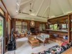 Comfortable family room with beautiful koa wood throughout