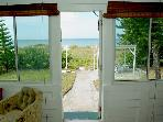 Back door opens to backyard and beach access