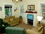 Living Room seating area with wide screen TV
