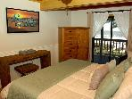 Master Bedroom with large flat screen TV and beautiful view of the Gulf