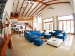 Spacious Living Room with High volt ceilings