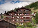 3 bedroom apartment with fireplace and  large south facing balcony and Matterhorn views.