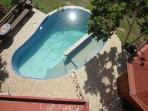 The pool, seen from the upper veranda. 2nd bathroom cabana and shower on the pool deck