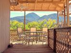 Covered deck with Sleeping Ute mountain view.