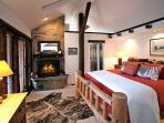 Master bedroom w/ fireplace and master bath with jetted tub and shower
