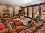 Family room with fireplace- walk out to hot tub