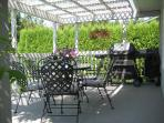 Gas BBQ on the upper deck off the kitchen. Wrought iron patio set with large table and seating for 6