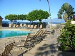 Large heated pool with plenty of lounge chairs to soak up the sun.