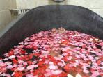 Soak in a warm flower petal bath at Eve Spa