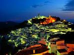 Nearby 'Pueblo Blanco' (white village) of Casares at night, perched on the side of a hill.