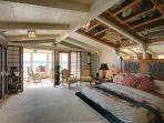 Airy, ocean front Master Suite with Sunroom.