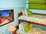 guest bedroom has a queen bed with overhead bunk bed , plus a twin bed