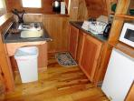 Kitchen (pots/pans, fridge, microwave, stove top, coffee maker, toaster)