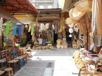 Traditional shops under apartment featuring weaving chair seats with cane, rush, and splints and several handmade...