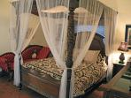 Bali Style Luxurious Canopy Bed and Fainting Sofa in Master Suite