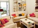 The living room is cozy and pleasant, with direct access to the terrace and library.