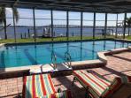 Enjoy Lounging around the heated pool