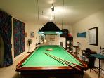 Enjoy a game of billiards in the games room