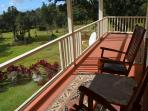 Enjoy a cup of Ka`u coffee overlooking the horse pasture