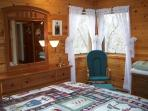 Our master bedroom has many windows that look out into the surrounding trees.