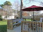 Deck overlooking large backyard, great for dining