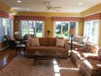 Sun room, w/ seating for 13 (2 ottomans behind sofa) & nice views of golf course