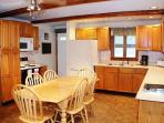 Kitchen has electric stove, microwave, large fridge, dishwasher and Jenair Grill