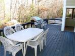 Large outside deck for cookouts has sliders to the kitchen area