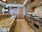 Gourmet Kitchen with Wolf Range, Oversized Subzero Refrigerator, Wine Refrigerator and Oversized Walk in Pantry