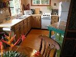 A fully-equipped kitchen and dining area provides modern convenience