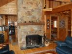 Floor to ceiling fieldstone fireplace in living room