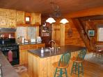 Custom knotty pine cabinets and Monson slate counters