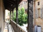 The balcony runs the full length of the house