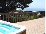 Enjoy our crystal clear hot tub with ocean and mountain views