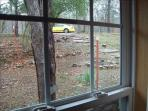 Looking out bedroom to parking area.