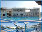 Large pool and waterslides at complex centre, restaurant, bar, shop children's play, tennis and more
