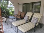 Comfortable and stylish outdoor furniture in the lanai area,all under a cooling fan,for total relax