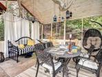 Screened in porch with dining