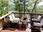 side deck seating overlooking the lake & New River Trail Trestle Bridge