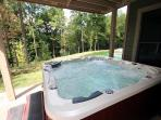 6 person hot tub on patio below 2nd story deck