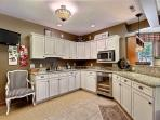 lower level kitchenette with extra microwave and wine refrigerator