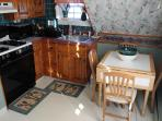Small kitchen that will seat 4 or you can take it outside to a spacious desk that is off the kitchen
