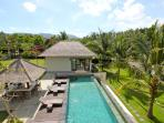 View of swimming pool, cocktail bar & guest house