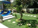 view towards footpath and pool loungers